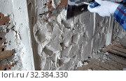 Купить «Plaster builder aligns plaster ironing plaster layer on brick wall,Repair and construction,Shot in 4K UHD», видеоролик № 32384330, снято 3 ноября 2009 г. (c) Куликов Константин / Фотобанк Лори