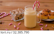 Купить «glass mug of eggnog, ingredients and sweets», видеоролик № 32385790, снято 2 ноября 2019 г. (c) Syda Productions / Фотобанк Лори