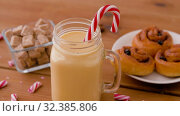 Купить «glass mug of eggnog, ingredients and sweets», видеоролик № 32385806, снято 2 ноября 2019 г. (c) Syda Productions / Фотобанк Лори