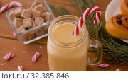 Купить «glass mug of eggnog, ingredients and sweets», видеоролик № 32385846, снято 2 ноября 2019 г. (c) Syda Productions / Фотобанк Лори