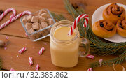 Купить «glass mug of eggnog, ingredients and sweets», видеоролик № 32385862, снято 2 ноября 2019 г. (c) Syda Productions / Фотобанк Лори