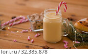 Купить «glass mug of eggnog, ingredients and sweets», видеоролик № 32385878, снято 2 ноября 2019 г. (c) Syda Productions / Фотобанк Лори