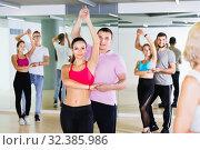 Купить «Group of young adults dancing salsa in club», фото № 32385986, снято 9 октября 2017 г. (c) Яков Филимонов / Фотобанк Лори