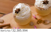 Купить «eggnog with whipped cream and spices on wood», видеоролик № 32385994, снято 2 ноября 2019 г. (c) Syda Productions / Фотобанк Лори