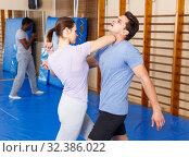 Купить «People practicing self defense techniques», фото № 32386022, снято 31 октября 2018 г. (c) Яков Филимонов / Фотобанк Лори
