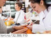 Manicurists giving manicure. Стоковое фото, фотограф Яков Филимонов / Фотобанк Лори