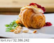 Купить «Mini croissant with camembert, jam, pine nuts», фото № 32386242, снято 16 июля 2020 г. (c) Яков Филимонов / Фотобанк Лори