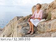 Купить «Senior woman relaxing at seaside», фото № 32389010, снято 6 июля 2018 г. (c) Яков Филимонов / Фотобанк Лори