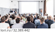 Купить «I have a question. Group of business people sitting in conference hall. Businessman raising his arm. Conference and Presentation. Business and Entrepreneurship», фото № 32389442, снято 30 сентября 2019 г. (c) Matej Kastelic / Фотобанк Лори