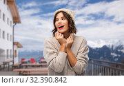 Купить «woman in winter hat and sweater at ski resort», фото № 32390842, снято 30 сентября 2019 г. (c) Syda Productions / Фотобанк Лори