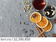 Купить «hot mulled wine, orange slices, raisins and spices», фото № 32390850, снято 4 октября 2018 г. (c) Syda Productions / Фотобанк Лори