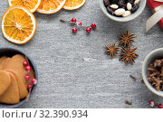 Купить «hot mulled wine, orange slices, raisins and spices», фото № 32390934, снято 4 октября 2018 г. (c) Syda Productions / Фотобанк Лори