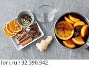 Купить «pot with hot mulled wine, orange slices and spices», фото № 32390942, снято 4 октября 2018 г. (c) Syda Productions / Фотобанк Лори