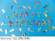 Купить «happy birthday of candies and confetti on blue», фото № 32390946, снято 11 декабря 2018 г. (c) Syda Productions / Фотобанк Лори