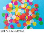 Купить «colorful confetti decoration on blue background», фото № 32390962, снято 11 декабря 2018 г. (c) Syda Productions / Фотобанк Лори