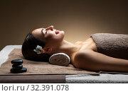 Купить «young woman lying at spa or massage parlor», фото № 32391078, снято 13 октября 2019 г. (c) Syda Productions / Фотобанк Лори