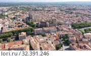 Купить «Scenic panoramic aerial view of residential areas of Narbonne with medieval Roman Catholic Cathedral on sunny summer day, France», видеоролик № 32391246, снято 30 августа 2019 г. (c) Яков Филимонов / Фотобанк Лори
