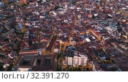 Купить «Picturesque view from drone of city of Valladolid at night, Spain», видеоролик № 32391270, снято 22 февраля 2020 г. (c) Яков Филимонов / Фотобанк Лори