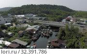 Купить «Fishing boats in Phu Quoc Island river 4K Drobe shot», видеоролик № 32391786, снято 5 ноября 2019 г. (c) Aleksejs Bergmanis / Фотобанк Лори