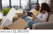 Купить «happy couple with tablet pc computer at new home», видеоролик № 32392018, снято 3 ноября 2019 г. (c) Syda Productions / Фотобанк Лори
