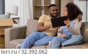Купить «happy couple with tablet pc computer at new home», видеоролик № 32392062, снято 3 ноября 2019 г. (c) Syda Productions / Фотобанк Лори