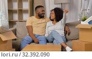 Купить «happy couple with house key moving to new home», видеоролик № 32392090, снято 3 ноября 2019 г. (c) Syda Productions / Фотобанк Лори