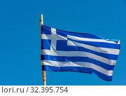Developing greek flag against a blue sky (2019 год). Стоковое фото, фотограф photoff / Фотобанк Лори
