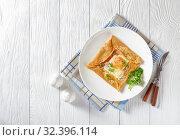 Купить «Savory Buckwheat Galettes Bretonnes with fried egg», фото № 32396114, снято 30 августа 2019 г. (c) Oksana Zh / Фотобанк Лори