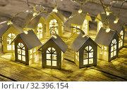 Купить «Светодиодная гирлянда из деревянных домиков», эксклюзивное фото № 32396154, снято 11 декабря 2018 г. (c) Dmitry29 / Фотобанк Лори