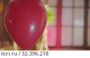 Купить «A red balloon passing by - a creepy clown on the background», видеоролик № 32396218, снято 10 декабря 2019 г. (c) Константин Шишкин / Фотобанк Лори
