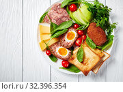 Купить «ploughman's lunch on a white plate, top view», фото № 32396354, снято 5 сентября 2019 г. (c) Oksana Zh / Фотобанк Лори