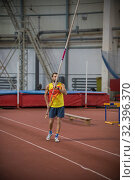 Купить «Pole vaulting - man is rising a long pole up», фото № 32396370, снято 1 ноября 2019 г. (c) Константин Шишкин / Фотобанк Лори