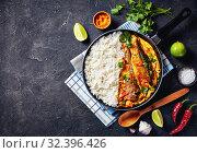 Купить «fish yellow curry with long grain rice», фото № 32396426, снято 11 сентября 2019 г. (c) Oksana Zh / Фотобанк Лори