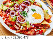 Купить «close-up of homemade chilaquiles on a plate», фото № 32396478, снято 13 сентября 2019 г. (c) Oksana Zh / Фотобанк Лори