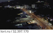 Купить «Night City life, Cars and bikes traffic on asphalt road in Vietnam 4K Drone shot», видеоролик № 32397170, снято 4 ноября 2019 г. (c) Aleksejs Bergmanis / Фотобанк Лори