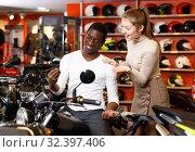 Купить «Happy young couple satisfied with choice in modern motorcycle salon», фото № 32397406, снято 16 января 2019 г. (c) Яков Филимонов / Фотобанк Лори