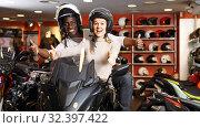 Nice young couple laughing sitting on bike. Стоковое фото, фотограф Яков Филимонов / Фотобанк Лори