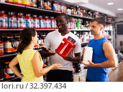 Купить «physically fit people discussing modern sport nutrition», фото № 32397434, снято 17 ноября 2019 г. (c) Яков Филимонов / Фотобанк Лори