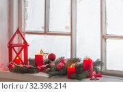 Купить «Christmas decorations on old wooden window», фото № 32398214, снято 9 января 2019 г. (c) Майя Крученкова / Фотобанк Лори