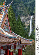 Купить «Curved roofs of colorful Chinese temple and Nachi waterfalls on the background. Wakayama. Japan», фото № 32398454, снято 27 октября 2007 г. (c) Serg Zastavkin / Фотобанк Лори