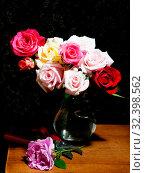 Купить «Colorful roses and pruner on table», фото № 32398562, снято 3 июня 2019 г. (c) Короленко Елена / Фотобанк Лори