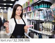 Купить «Professional young female hairdresser with hair cutters», фото № 32398906, снято 31 марта 2018 г. (c) Яков Филимонов / Фотобанк Лори