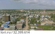 Купить «Sihanoukville city in Cambodia drone shot 4K», видеоролик № 32399614, снято 25 октября 2019 г. (c) Aleksejs Bergmanis / Фотобанк Лори