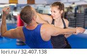 Купить «Young female and her trainer are practicing captures», фото № 32407138, снято 21 августа 2017 г. (c) Яков Филимонов / Фотобанк Лори