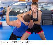 Купить «Female exercise fight with trainer on the self-defense course», фото № 32407142, снято 21 августа 2017 г. (c) Яков Филимонов / Фотобанк Лори