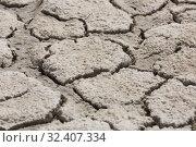 Купить «Cracked gray ground», фото № 32407334, снято 13 ноября 2019 г. (c) Яков Филимонов / Фотобанк Лори