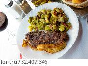 Купить «Delicious entrecote with a garnish of vegetables», фото № 32407346, снято 14 июня 2019 г. (c) Яков Филимонов / Фотобанк Лори