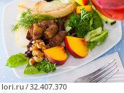 Купить «Salad with roasted chicken hearts, pears», фото № 32407370, снято 18 ноября 2019 г. (c) Яков Филимонов / Фотобанк Лори