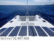 Luxury solar powered catamaran, fully sustainable and powered by solar energy, charging batteries aboard a sailboat, vessel in ocean waters, nobody. Photovoltaic panels renewable eco energy concept. Стоковое фото, фотограф Alexander Tihonovs / Фотобанк Лори