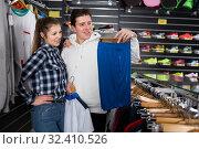 Купить «couple is looking on shorts for tennis», фото № 32410526, снято 7 февраля 2018 г. (c) Яков Филимонов / Фотобанк Лори